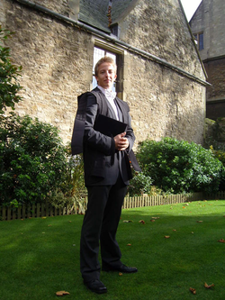 An undergraduate student at the University of Oxford in subfusc for matriculation