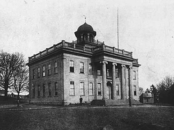 The original University of Washington building on Denny's Knoll, c. 1870