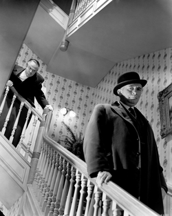 Welles fell ten feet while shooting the scene in which Kane shouts at the departing Boss Jim W. Gettys; his injuries required him to direct from a wheelchair for two weeks.