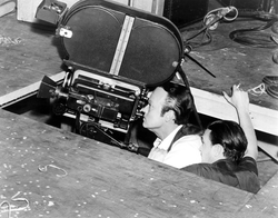 Welles and cinematographer Gregg Toland prepare to film the post-election confrontation between Kane and Leland, shot from an extremely low angle that required cutting into the set floor.