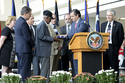 Cruz presents U.S. flag to World War II veteran                                 Richard Arvine Overton                                during opening ceremony for outpatient clinic in                                 Austin                                on August 22, 2013