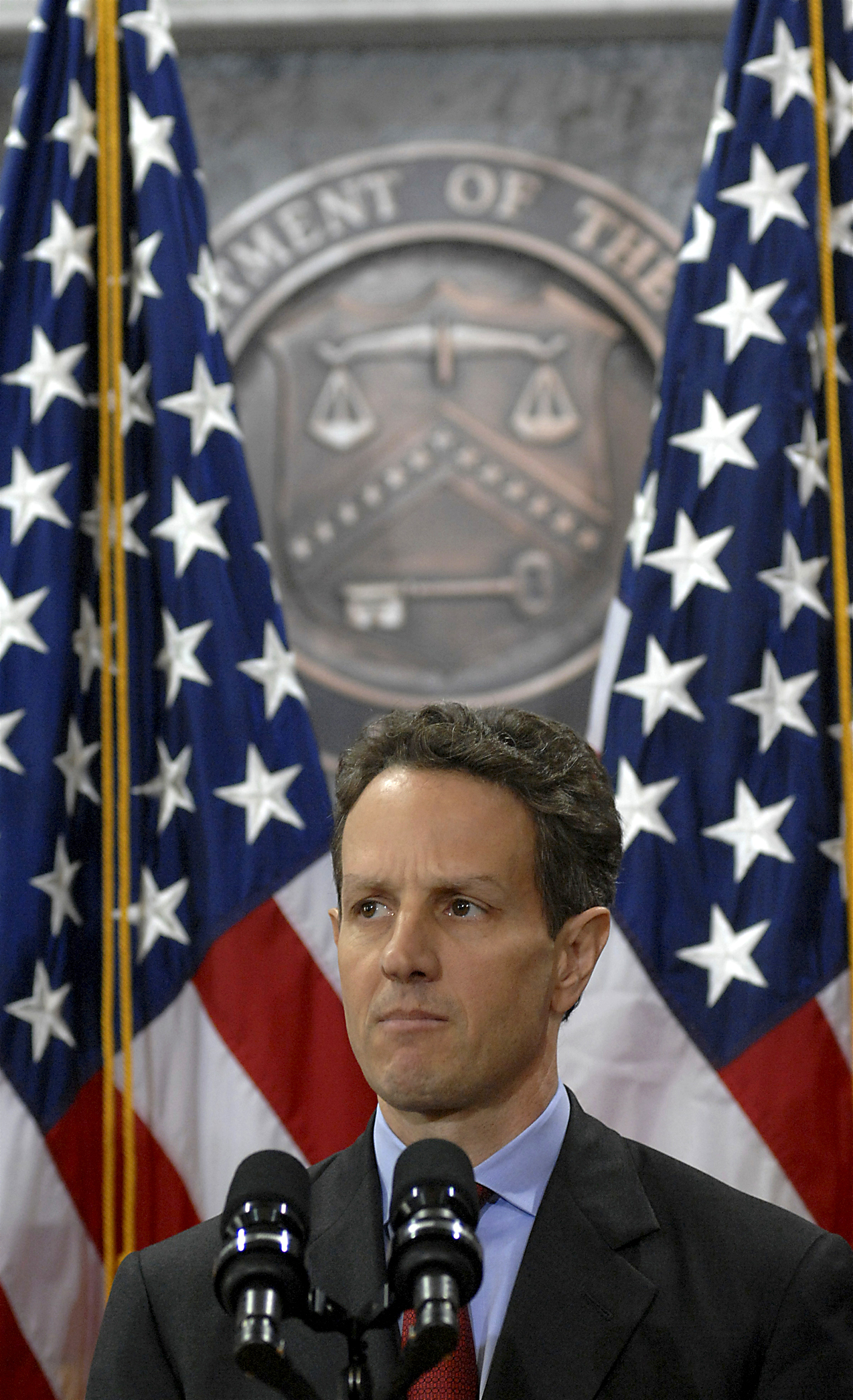 Geithner speaking at the United States Department of Treasury.