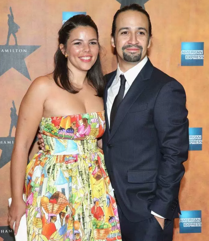 With her husbandLin-Manuel Miranda.