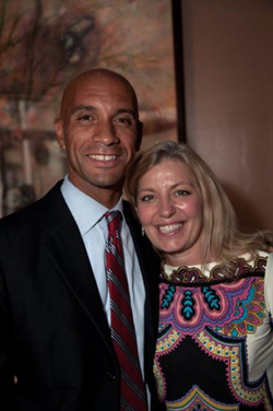 Adrian Fenty with Laurene Powell Jobs​.