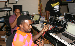 West working in the studio in 2008, accompanied by mentor No I.D. (left).