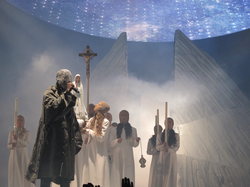 West performing in 2013 as part of the Yeezus Tour.
