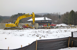 Renovation of                                 Weston Field                                Athletic Complex - January 2014. The wooden grandstand behind the excavator was built in 1902. It was moved in 1987 to the new Plansky Track and football field and was moved again during the renovations that were completed in September 2014.