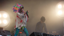 Karen O and Nick Zinner performing at the Glastonbury Festival 2009