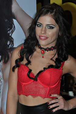 Adriana in a red outfit.