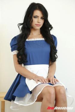 Adriana in a cute blue dress.