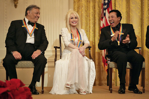 Conductor Zubin Mehta laughs with singers Dolly Parton and Robinson during a reception for the Kennedy Center honorees in the East Room of the White House on Sunday, December 3, 2006.