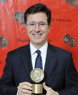 Colbert with his                                 Peabody Award                                , May 2012