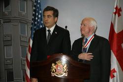 President  Mikheil Saakashvili  of  Georgia  awards a  National Hero of Georgia  order to McCain, January 2010
