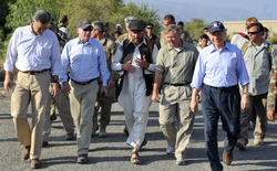 """The """"Three Amigos"""" walking in  Kunar Province  in eastern Afghanistan in July 2011: McCain (second from left),  Lindsey Graham  (second from right in front),  Joe Lieberman  (right in front).   [229]"""