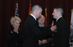 McCain and his wife Cindy watch in 2011 as their son Jimmy pins aviator wings on their son Ensign John Sidney McCain IV