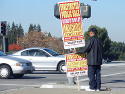 Paying people to hold signs is one of the oldest forms of advertising, as with this                                 human billboard                                .