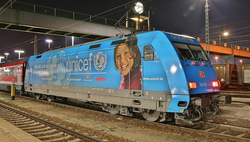 A                                 DBAG Class 101                                with                                 UNICEF                                ads at Ingolstadt main railway station.