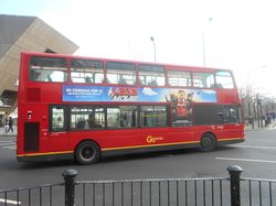 A                                 London Bus                                , with a                                 film                                advertisement along its side.