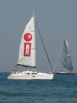 The                                                   RedEye                                                 newspaper advertised to its target market at                                 North Avenue Beach                                with a sailboat billboard on                                 Lake Michigan                                .