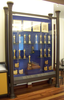 Display case in the lobby of The Walt Disney Family Museum showing many of the Academy Awards won by Disney