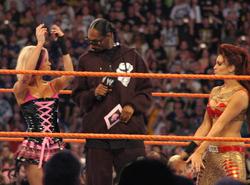 Snoop Dogg at WrestleMania XXIV at Orlando's Citrus Bowl with Ashley Massaro and tag team partner Maria, March 30, 2008