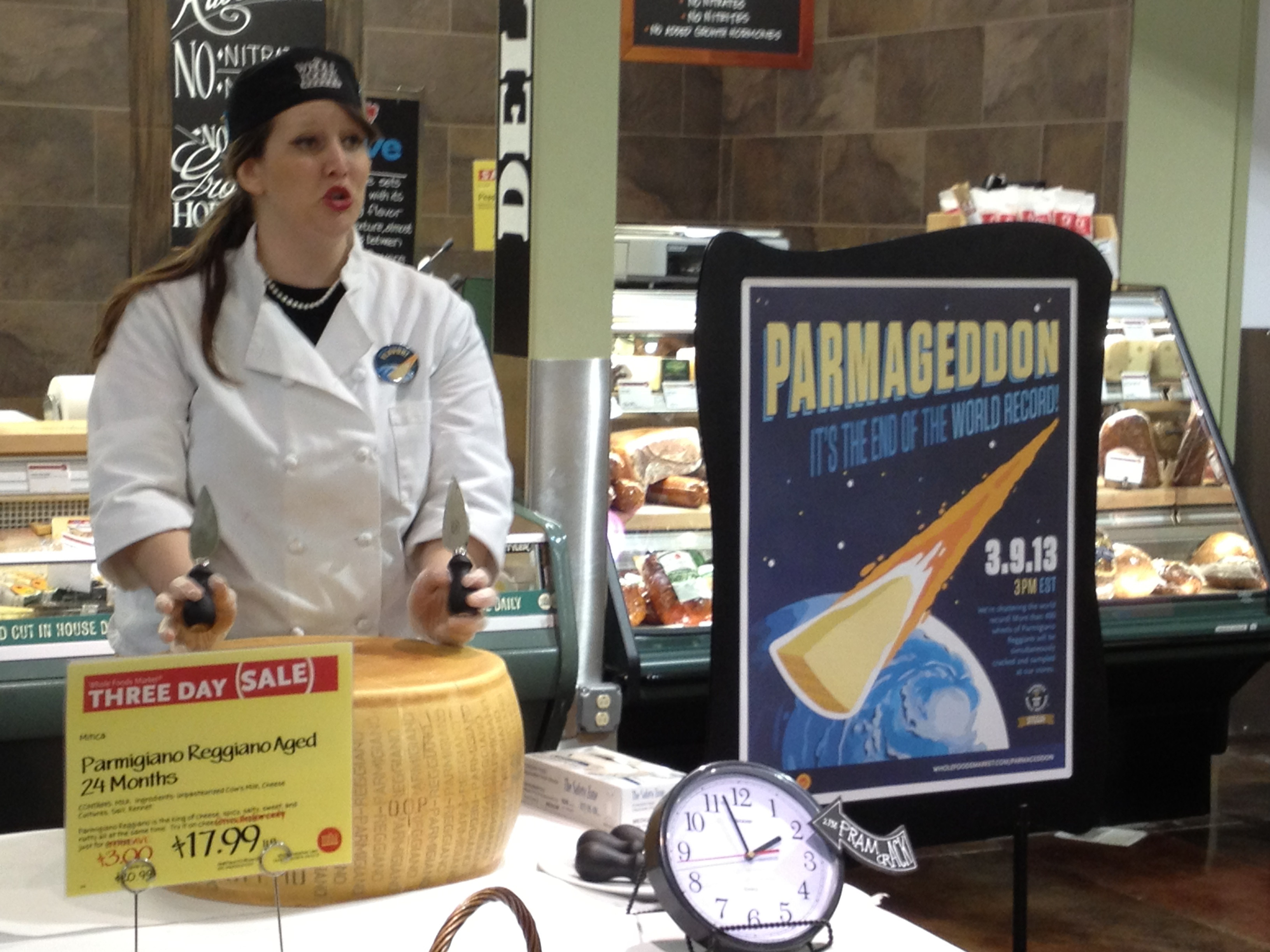 Preparing to break open a wheel of Parmigiano-Reggiano cheese at Whole Foods Market in Overland Park, Kansas