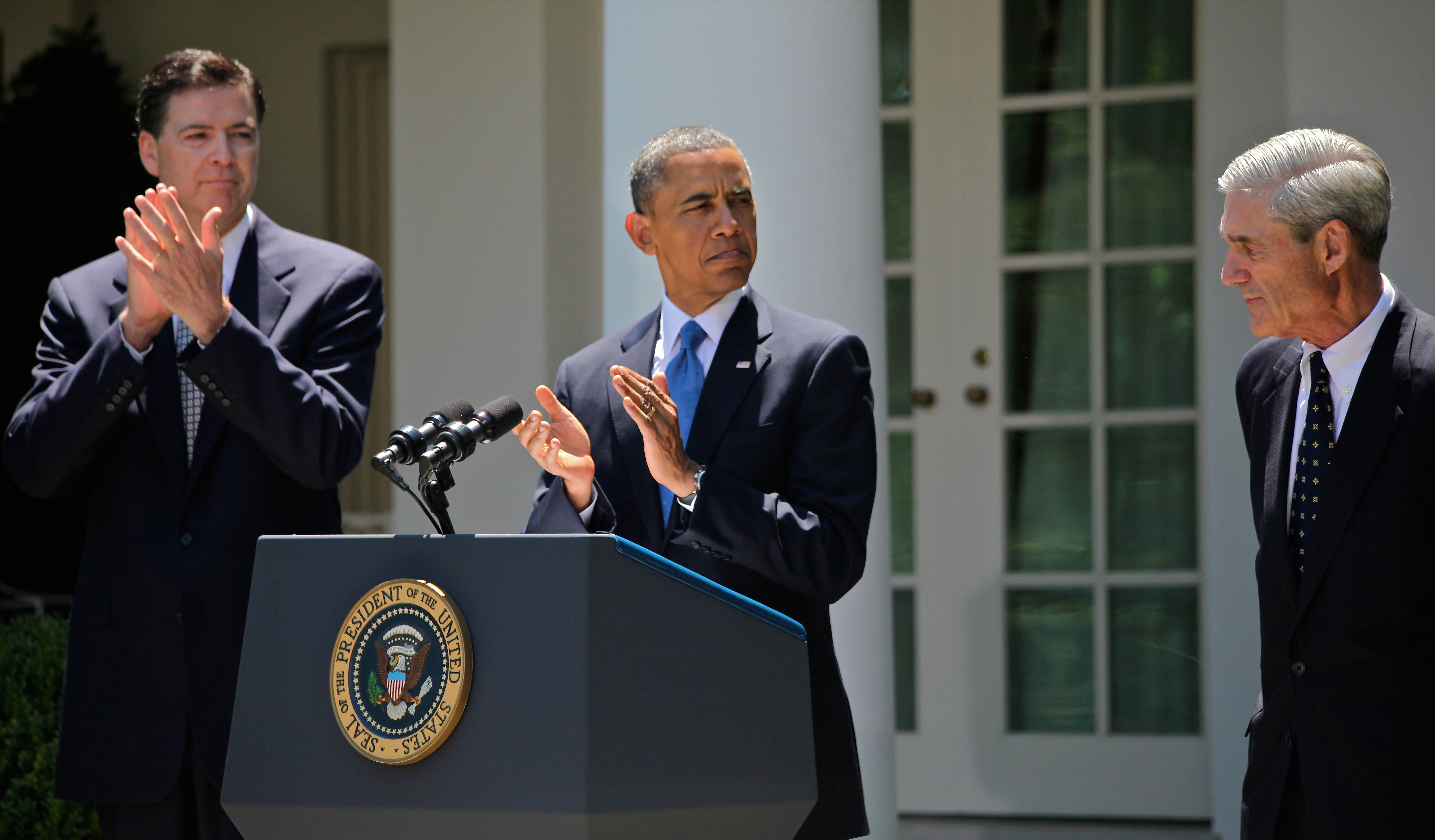 Comey (left), alongside President Barack Obama (center) and outgoing FBI Director Robert Mueller (right) at Comey's nomination to become the seventh Director of the FBI, June 21, 2013