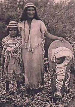 Southern                                 Paiutes                                at                                 Moapa                                wearing traditional Paiute basket hats with Paiute cradleboard and rabbit robe