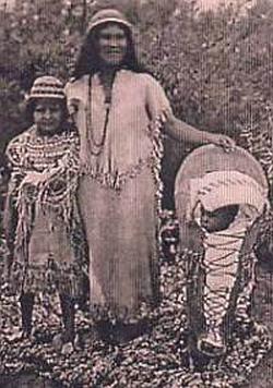 Southern Paiutes at Moapa wearing traditional Paiute basket hats with Paiute cradleboard and rabbit robe
