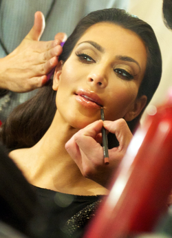 Kardashian backstage at                                 The Heart Truth                                's Red Dress Collection, February 2010