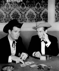 James Garner                                and                                 Jack Kelly                                in                                                   Maverick                                                 (1957).