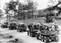 US Army                                trucks loaded with                                 US Marshals                                on the University of Mississippi campus.