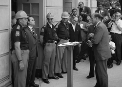 Alabama governor                                 George Wallace                                stands against desegregation at the                                 University of Alabama                                and is confronted by US Deputy Attorney General                                 Nicholas Katzenbach                                in 1963.