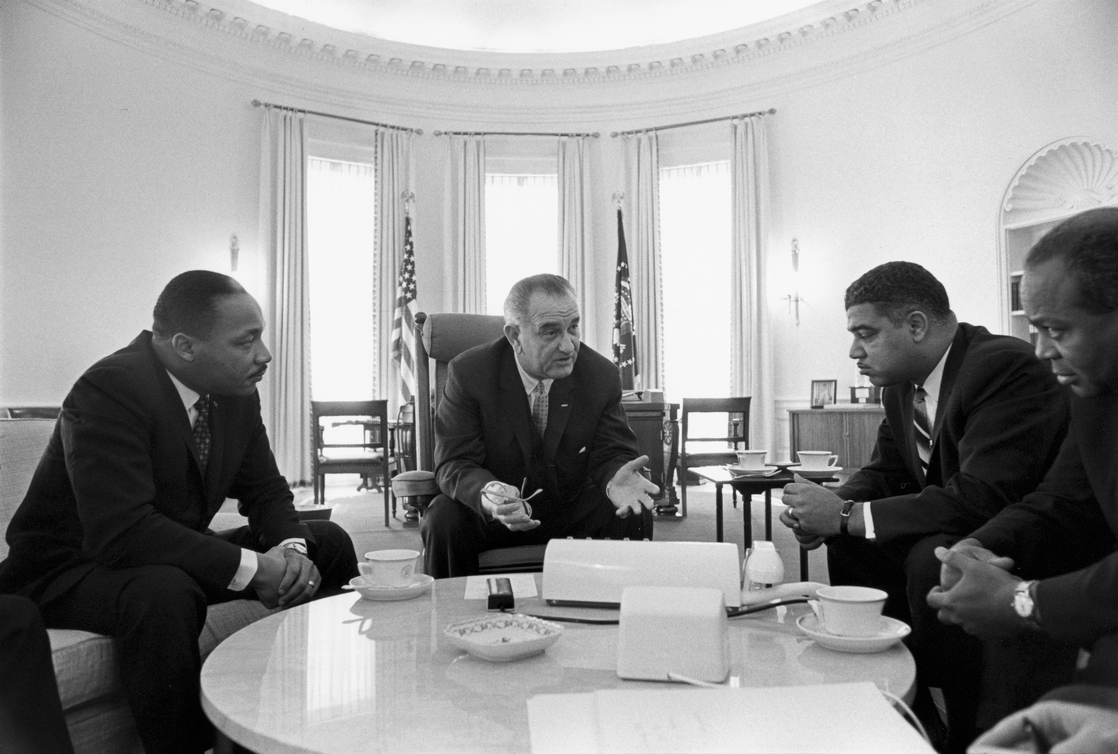 President Lyndon B. Johnson meets with Civil Rights leaders Martin Luther King, Jr., Whitney Young, and James Farmer, January 1964.