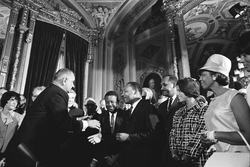 President Johnson,                                 Martin Luther King, Jr.                                at the signing of the                                 Voting Rights Act                                on August 6, 1965.