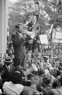 Robert F. Kennedy                                speaking to a Civil Rights crowd in front of the                                 Justice Department                                building, June 1963.