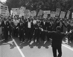 Jewish civil rights activist                                 Joseph L. Rauh, Jr.                                marching with                                 Martin Luther King                                in 1963.