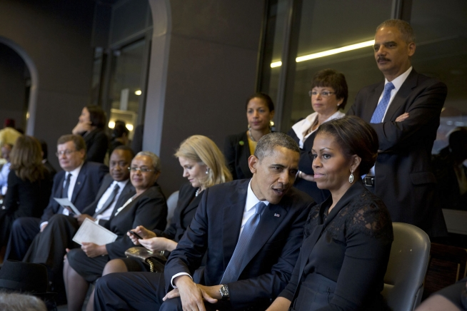 Rice (next to column behind President Obama) at Nelson Mandela's funeral in South Africa, December 2013