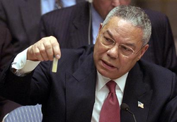 Colin Powell, the US Secretary of State, demonstrates a vial with alleged Iraqi chemical weapon probes to the UN Security Council on Iraq war hearings, 5 February 2003