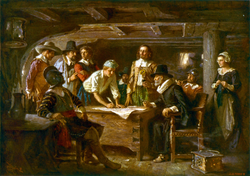 The signing of the Mayflower Compact, 1620.