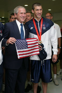 Swimmer Michael Phelps and then-President George W. Bush August 10, 2008 at the National Aquatic Center in Beijing. Phelps is the most decorated Olympic athlete of all time.[568][569]