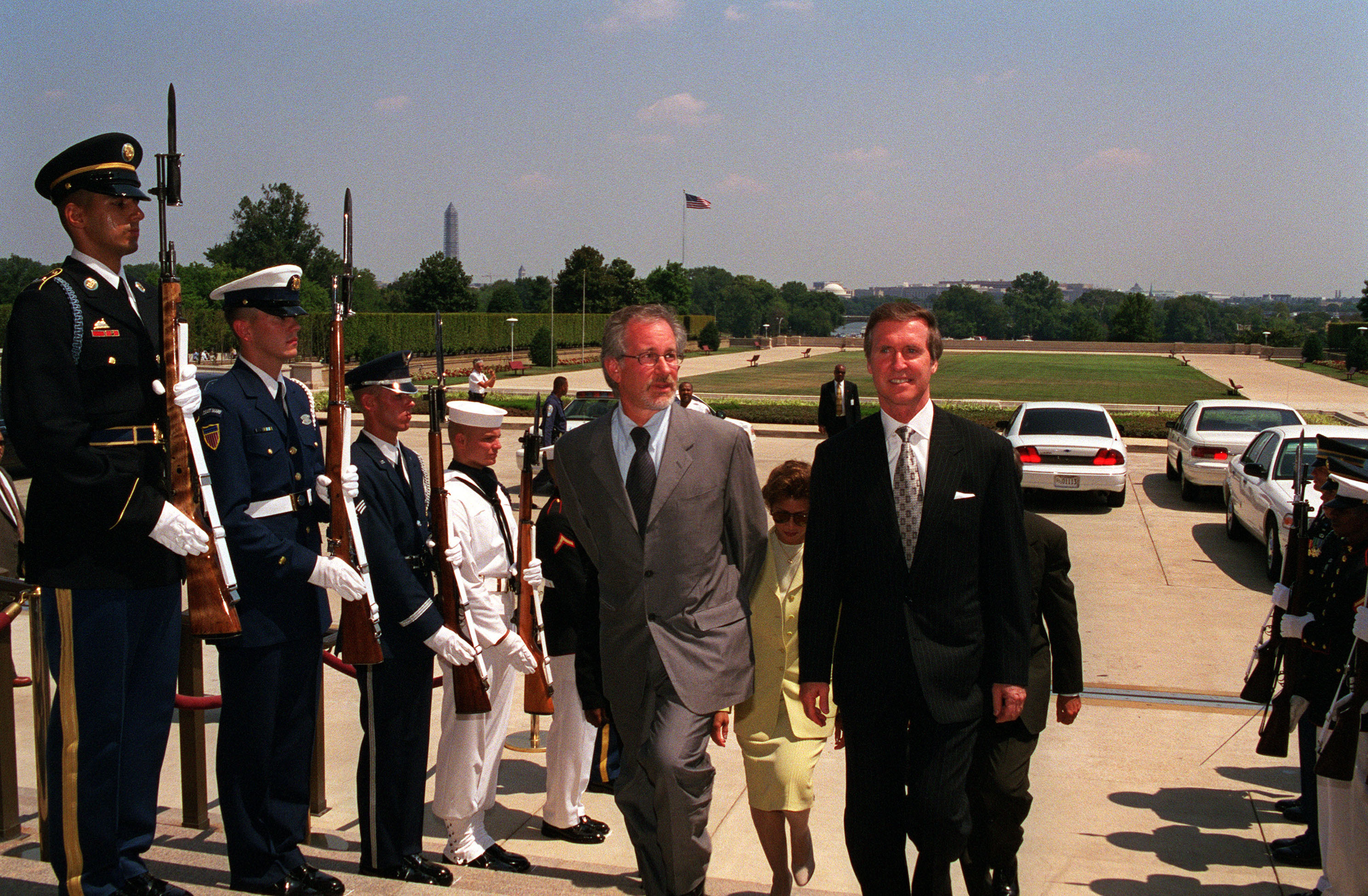 Secretary of Defense William S. Cohen escorts Spielberg through a military honor cordon into the Pentagon.