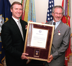Spielberg receiving a public service award presented by United States Secretary of Defense William Cohen, 1999