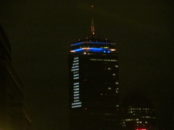 """The Prudential Tower lit up with a large """"1"""" for the One Fund Boston, a week after the bombing"""