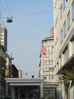 Flag flying at half mast at the American consulate in Milan, Italy