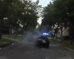 Screenshot from the video of smoke pouring out of the Jaguar XK (X100) convertible, Paul was driving during the shooting