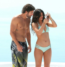 Kylie swimming with her half brother Brody Jenner