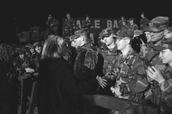 Clinton greets U.S. troops at Tuzla Air Base in Bosnia during a visit in December 1997.