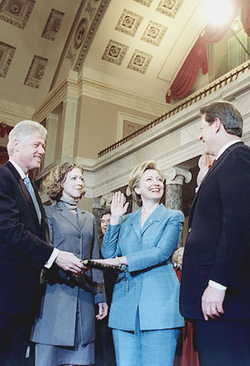 Reenactment of Hillary Rodham Clinton being sworn in as a U.S. senator by Vice President Al Gore in the Old Senate Chamber, as her husband Bill, and daughter Chelsea, look on. January 3, 2001.