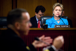 Senator Clinton listens as the Chief of Naval Operations, Admiral Mike Mullen, responds to a question during his 2007 confirmation hearing with the Senate Armed Services Committee.